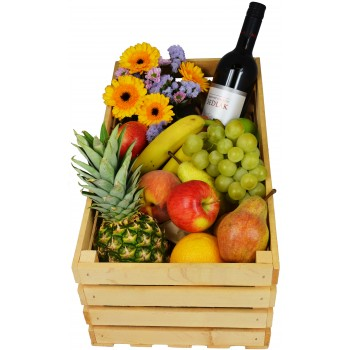 Wooden box with fruits and Sedlák wine